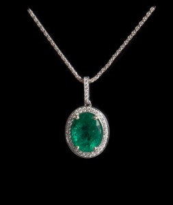 18ct white gold oval emerald halo pendant and chain